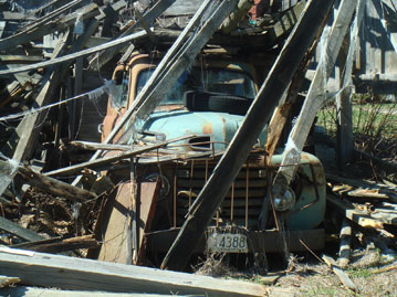 Old Vermont truck covered with construction discards