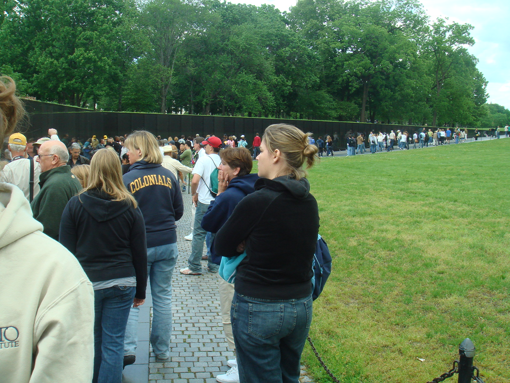 People by Vietnam Veterans Memorial Wall