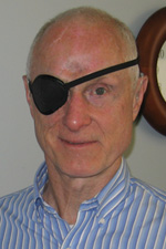 Photo of Bill Raeder with his patch over his right eye
