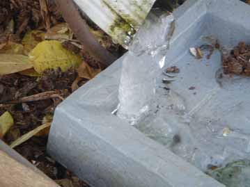 Ice at the end of a downspout