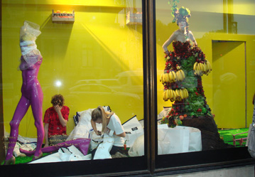 London shop window with a mannequin dressed in an array of fruit