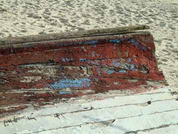 Weathered side of a wooden boat