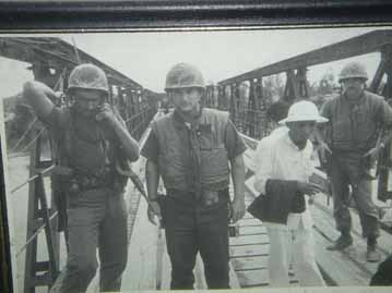A very young Tom on a bridge in Vietnam