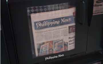 Philippine News in a newspaper vending box