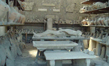 Body cast in stone at the ruins in Pompeii