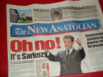 Newspaper with Sarkozy's picture and headline Oh, No!